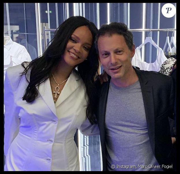 """Rihanna et Marc-Olivier Fogiel au cocktail de lancement de """"Fenty"""". Paris, le 22 mai 2019."""