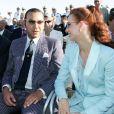 Le roi Mohammed VI du Maroc et la princesse Lalla Salma sur le Charles-de-Gaulle à Toulon le 15 août 2014 avec Jacques et Bernadette Chirac.