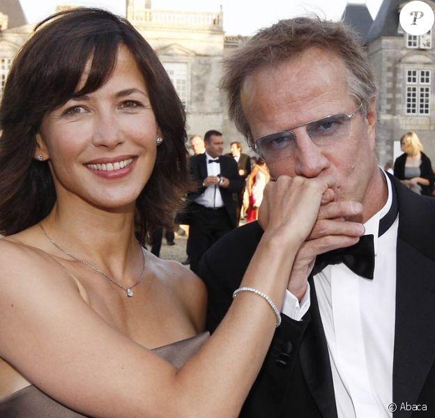 Christophe Lambert et Sophie Marceau ; terriblement romantiques lors de la Fête de la Fleur (Gironde, le 25 juin 2009)