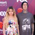 """Travis Barkeret ses enfants au photocall des """"2019 iHeart Radio Music Awards"""" au Microsoft Theatre à Los Angeles, le 14 mars 2019."""