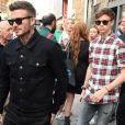 David Beckham et son fils Romeo lors d'une sortie père fils à Milan le 19 juin 2019.