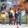 Laeticia Hallyday et ses filles Jade et Joy à leur arrivée à l'aéroport de Saint-Barthélemy. Son amie Liliane Jossua et son fils Gabriel Bogliolo sont venus les accueillir. Le 4 décembre 2019.