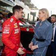 Charlene de Monaco et le pilote de Formule 1  Charles Leclerc lors du Grand-Prix d' Abu Dhabi, le 1er décembre 2019.