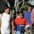 Christina Milian, enceinte, dans une robe moulante blanche à la sortie de chez Fred Segal's avec son compagnon M.Pokora et sa fille, Violet Madison Nash, après avoir déjeuné avec des amis, à Los Angeles, Californie, Etats-Unis, le 7 janvier 2020.