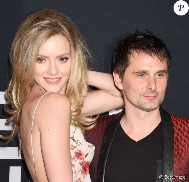 Elle Evans et son comapgnon Matt (Matthew) Bellamy - People au défilé Saint-Laurent à Hollywood le 10 février 2016.