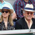 Nelson Monfort et sa femme Dominique dans les tribunes lors des internationaux de tennis de Roland Garros à Paris, France, le 3 juin 2019. © Jacovides-Moreau/Bestimage