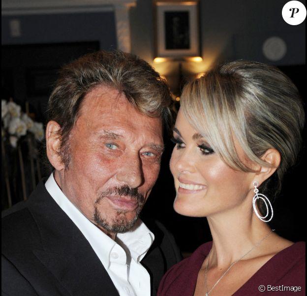 Exclusif- Johnny Hallyday et sa femme lors d'une soirée chez Christian Audigier à Los Angeles.