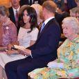"""Meghan Markle, duchesse de Sussex, le prince Harry, duc de Sussex, la reine Elisabeth II d'Angleterre - Personnalités à la cérémonie """"Queen's Young Leaders Awards"""" au palais de Buckingham à Londres le 26 juin 2018."""