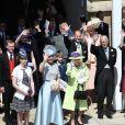 Le prince Harry, duc de Sussex, et Meghan Markle, duchesse de Sussex, en calèche et La reine Elisabeth II d'Angleterre, Le prince Philip, duc d'Edimbourg, Le prince Edward, comte de Wessex, Sophie Rhys-Jones, comtesse de Wessex, James Viscount Severn, Lady Louise Windsor, La princesse Anne, Le prince Michael de Kent et La princesse Michael de Kent à la sortie du château de Windsor après leur mariage le 19 mai 2018.