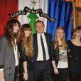 Jean-Charles de Castelbajac avec le groupe Les Plastiscines devant sa création lors de la vente aux enchère des Sapins de créateurs qui se tient à la Cité de l'architecture le 8 décembre 2009 à Paris