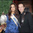 Malika Ménard, Miss France 2010, et Xavier Brunet lors d'une soirée chez Castel à Paris le 9 décembre 2009