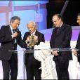 Charles Aznavour, Michel Drucker, Frédéric Mitterrand et Nagui à la cérémonie des Victoires de la Musique 2010.