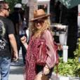 Paulina Rubio se balade dans les rues de Miami, aux côtés de son mari, Nicolas, jeudi 22 avril.