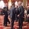 Nicolas Sarkozy et Gilbert Coullier à la remise de son insigne, le 20 mai 2010.