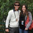 Gustavo Kuerten et une amie à Roland-Garros lors des internationaux de tennis le 2 juin 2010