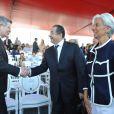 Jean-David Levitte, Guillaume Sarkozy et Christine Lagarde assistent au défilé du 14 juillet 2010.