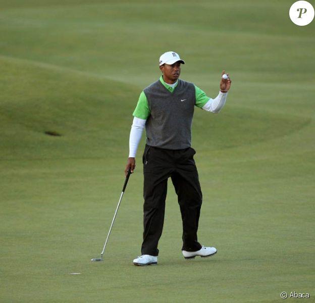 Toujours en quête d'un 15e succès dans un tournoi majeur, Tiger Woods peine à retrouver les sommets depuis le scandale de ses infidélités conjugales... Le british Open de Saint Andrews (photo le 16 juillet) ne fait pas exception.