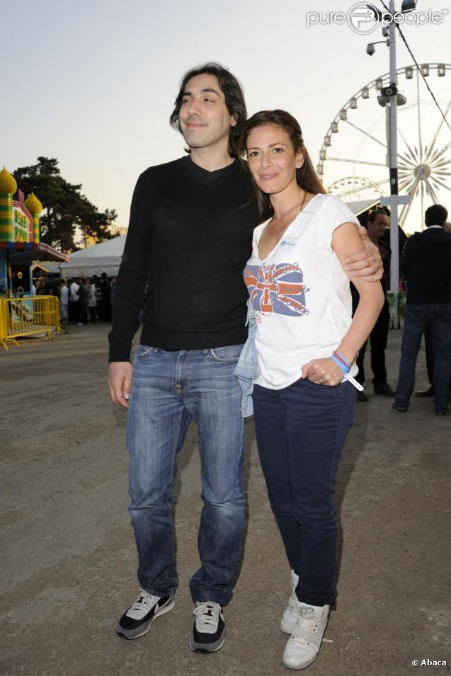 Elsa Fayer et son compagnon à l'ouverture de la Foire du Trône, au profit de l'association Les Petits Princes, le 8 avril 2011