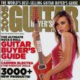 Carmen Electra en shorty rose, joue à la rockeuse pour Guitar Buyer's. Novembre 2005.