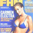 La très sensuelle Carmen Electra sublime en bikini et sur fond bleu, pour couvrir le FHM allemand. Juin 2011.