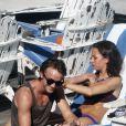 Tom Felton et Jade Olivia, au bord d'une piscine à Miami (Floride), le vendredi 30 décembre 2011.