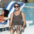 Tom Felton, au bord d'une piscine à Miami (Floride), le vendredi 30 décembre 2011.
