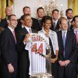 Barack Obama et sa femme Michelle le 17 janvier 2012 lors d'une cérémonie rendant hommage aux Cardinals de Saint-Louis à la Maison Blanche à Washington
