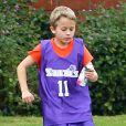 Ryan Phillippe assiste avec sa fille Ava au match de basket de son fils Deacon à Brentwood le 21 janvier 2012 : son fiston, qu'il a eu avec Reese Witherspoon, est un as du ballon