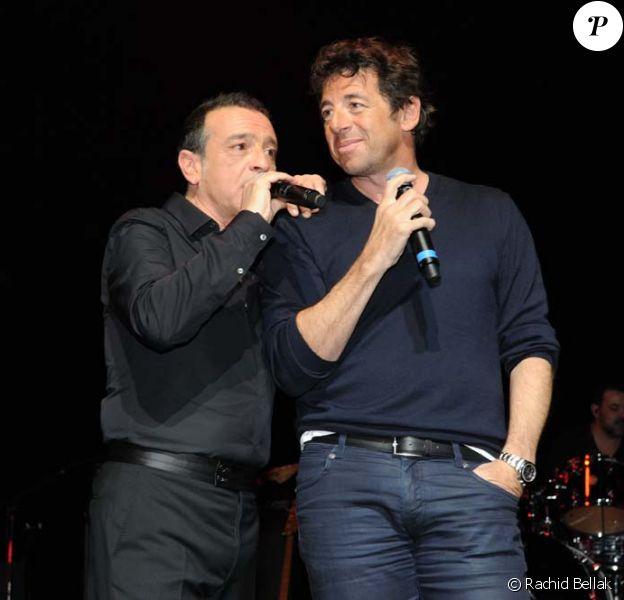 Patrick Bruel rejoint Félix Gray sur la scène de l'Olympia à Paris, le 7 mars 2012.