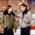 Eric Charden et son fils Baptiste au Téléthon en 1987