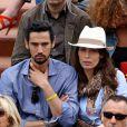 Dolores Chaplin et son compagnon Stany Coppet. Les people étaient nombreux au rendez-vous de la finale féminine de Roland-Garros, samedi 9 juin 2012, pour assister au premier sacre à Paris de Maria Sharapova.