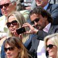 Henri Leconte et sa femme Florentine. Les people étaient nombreux au rendez-vous de la finale féminine de Roland-Garros, samedi 9 juin 2012, pour assister au premier sacre à Paris de Maria Sharapova.