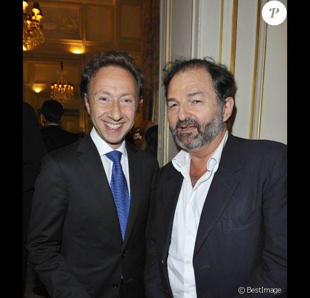 Stéphane Bern et Denis Olivennes, à l'occasion de la remise des insignes de Chevalier dans l'Ordre des arts et des lettres à Franck Ferrand, le 20 juin 2012 à l'hôtel Plaza à Paris.