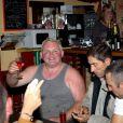 EXCLU - Thierry Olive de L'Amour est dans le pré, rayonnant, lève son verre lors de son enterrement de vie de garçon la veille de son mariage avec Annie dans le village de Gavray en compagnie des anciens candidats de l'émission le 14 septembre 2012