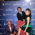 Christian Louboutin, la gagnante du concours et Stéphane Bern lors de la soirée Louboutin pour Cendrillon au Grand Rex à Paris le 25 septembre 2012