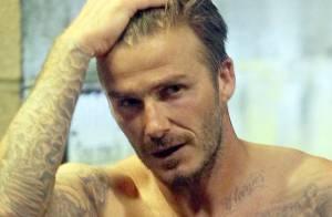 David Beckham : Battu et abattu, mais sexy torse nu dans les vestiaires