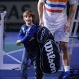 """""""Michaël Llodra et son adorable fils Théo après sa victoire sur John Isner lors du Masters 1000 de Paris Bercy le 31 octobre 2012"""""""