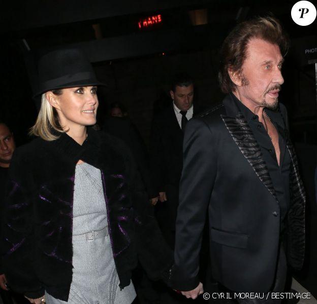 Johnny Hallyday et Laeticia quittent la soirée Chanel pour l'exposition La Petite Veste Noire au Grand Palais, le 8 novembre 2012 à Paris.