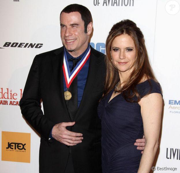 John Travolta et Kelly Preston posent pour les photographes à la 10e cérémonie annuelle Living Legends of Aviation Awards à Beverly Hills, le 18 janvier 2013.
