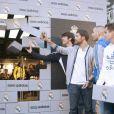 Kaka, Xabi Alonso, Karim Benzema et les joueurs du Real de Madrid lors de l'inauguration de la nouvelle boutique Adidas au stade Santiago Bernabeu de Madrid le 21 février 2013