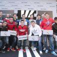 Angel di Maria, Karim Benzema, Xabi Alonso, Iker Casillas, Kaka et les joueurs du Real Madrid lors de l'inauguration de la nouvelle boutique Adidas au stade Santiago Bernabeu de Madrid le 21 février 2013