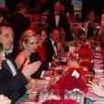Gad Elmaleh et Charlotte Casiraghi pendant le dîner lors du Bal de la Rose, le 23 mars 2013, au Sporting de Monte-Carlo. En l'honneur du 150e anniversaire de la Société des Bains de mer, Karl Lagerfeld avait été mandaté par son amie la princesse Caroline pour imaginer une soirée exceptionnelle : Belle et Pop, une traversée du temps de la Belle Epoque à l'ère pop.