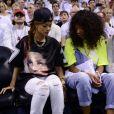 Rihanna et Melissa Forde assistent à la rencontre entre les Miami Heat et les Milwaukee Bucks à l'American Airlines Arena. Miami, le 21 avril 2013.