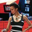 Sonia Rolland tente de séduire le public des Trace Urban Music Awards avec des faux attributs et une robe très moulante. Paris, le 14 mai 2013.