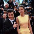 Thomas Langmann et Céline Bosquet à la montée des marches du film Inside Llewyn Davis lors du 66e festival du film de Cannes, le 19 mai 2013.