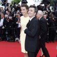 Thomas Langmann et Céline Bosquet, tout sourire pendant la montée des marches du film Inside Llewyn Davis lors du 66e festival du film de Cannes, le 19 mai 2013.