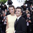 Thomas Langmann et Céline Bosquet pendant la montée des marches du film Inside Llewyn Davis lors du 66e festival du film de Cannes, le 19 mai 2013.
