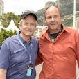 Michael Douglas, Gerhard Berger dans les allées du paddock du Grand Prix de F1 de Monaco le 25 mai 2013