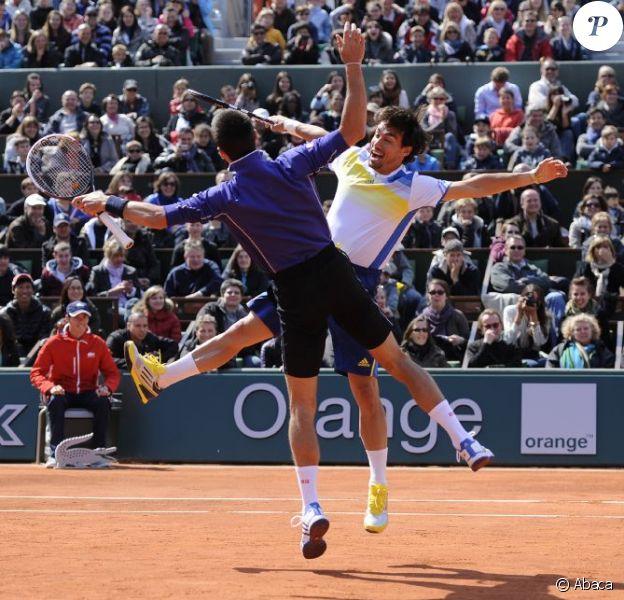 Novak Djokovic et Fabio Fognini lors de la Journée des Enfants de Roland-Garros la veille du début du tournoi, le 25 mai 2013
