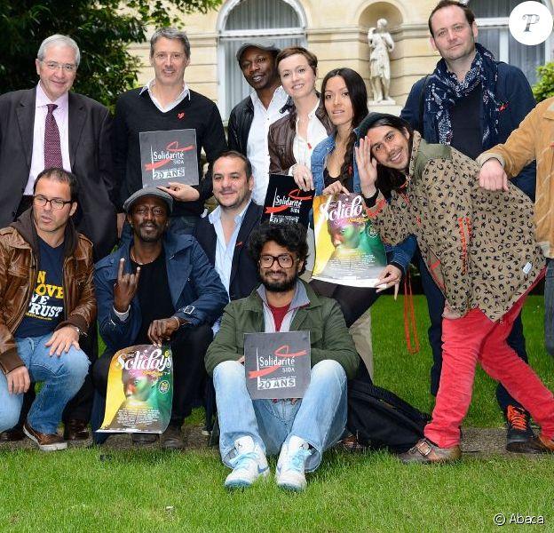 """Wax Tailor, Jean-Paul Huchon, Antoine de Caunes, Mc Solaar, Mai Lan, Luc Barruet, Marco Prince, François-Xavier Demaison et Sébastien Folin lors de la conférence de presse """"Solidays 2013"""" à Paris le 29 mai 2013."""